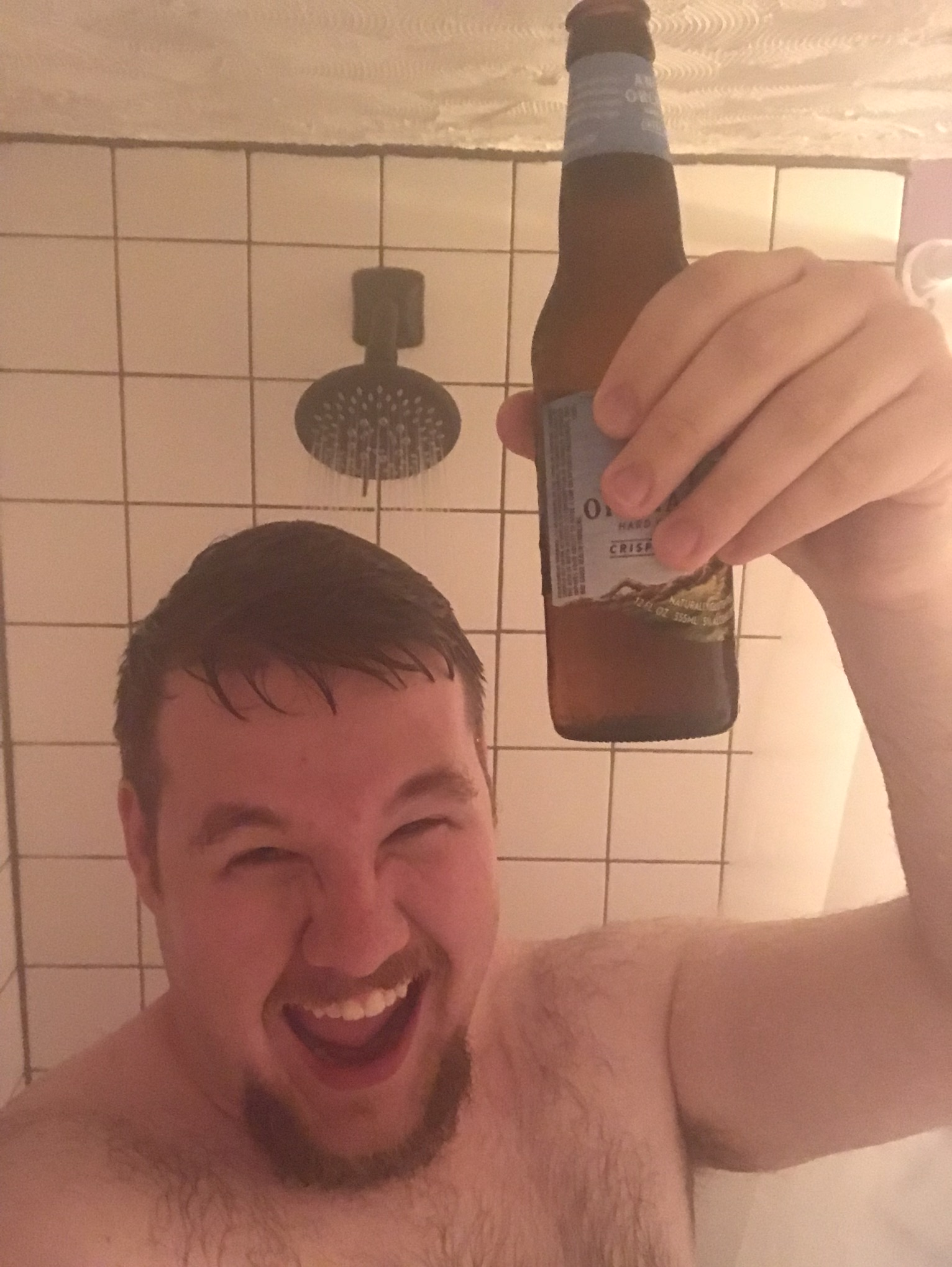 Enjoying a beverage in the shower